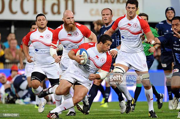 Biarritz's prop Eugene Van Staden runs with the ball during the French Top 14 rugby match between Castres Olympique and Biarritz at the Pierre...