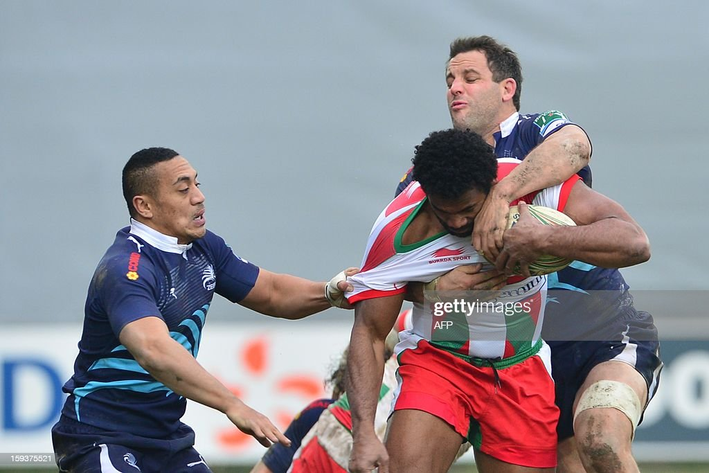 Biarritz's Seramaia Burotu (C) vies with Zebre's winger Sinoti Sinoti (L) and Zebre's No. 8 Joshua Sole during the European Rugby Union H Cup match Zebre Parme vs Biarritz Olympique at the XXV Aprile stadium in Parma on January 12, 2013.