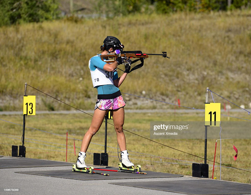Biathalon racer trains in summer, shooting range : Stock Photo