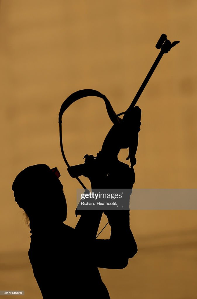 Biathlete <a gi-track='captionPersonalityLinkClicked' href=/galleries/search?phrase=Andrea+Henkel&family=editorial&specificpeople=233764 ng-click='$event.stopPropagation()'>Andrea Henkel</a> of Germany shoots during a training session ahead of the Sochi 2014 Winter Olympics at the Laura Cross-Country Ski and Biathlon Center on February 6, 2014 in Sochi, Russia.