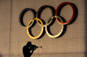 Biathlete Cristoph Stefan of Germany shoots during a training session ahead of the Sochi 2014 Winter Olympics at the Laura CrossCountry Ski and...