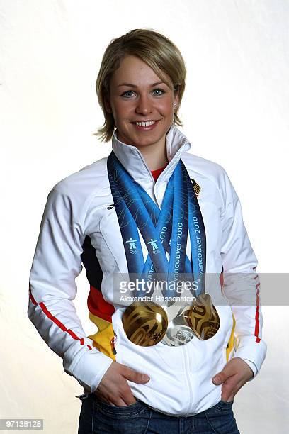 Biathlete Magdalena Neuner of Germany poses for a photo with her medals won on day 16 of the 2010 Vancouver Winter Olympics at Hilton hotel on...