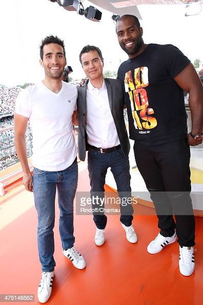 Biathlete Martin Fourcade Sports journalist Laurent Luyat and Judoka Teddy Riner pose at France Television french chanel studio during the 2015...