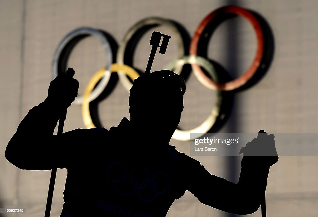 A biathlete passes the Olympic rings during a training session ahead of the Sochi 2014 Winter Olympics at the Laura Cross-Country Ski and Biathlon Center on February 5, 2014 in Sochi, Russia.