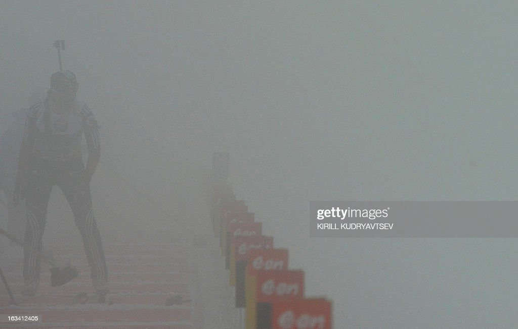 A biathlete prepares to shoot in major fog during a training session for the Women's 7,5 km Sprint during the IBU World Cup Biathlon at Laura Cross Country and Biathlon Center in the Russian Black Sea resort of Sochi on March 9, 2013. AFP PHOTO/KIRILL KUDRYAVTSEV
