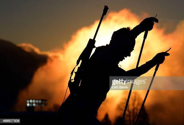A biathlete trains ahead of the Sochi 2014 Winter Olympics at the Laura CrossCountry Ski and Biathlon Center on February 5 2014 in Sochi Russia
