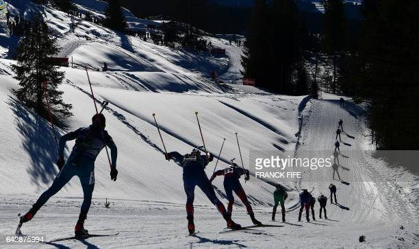 TOPSHOT Biathletes compete during the men's 15 km mass start race at the Biathlon World Championships in Hochfilzen Austria on February 19 2017 / AFP...