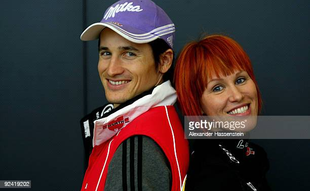 Biathlon athlete Kati Wilhelm poses with Ski Jumper Martin Schmitt after a press conference at the German athlete Winter kit preview at the adidas...