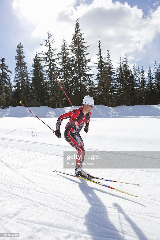 Biathlon athlete quickly skis