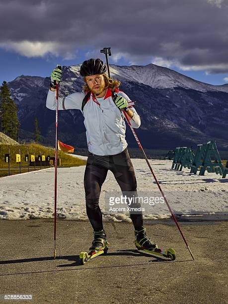 Biathlon athlete skiing with competition rifle