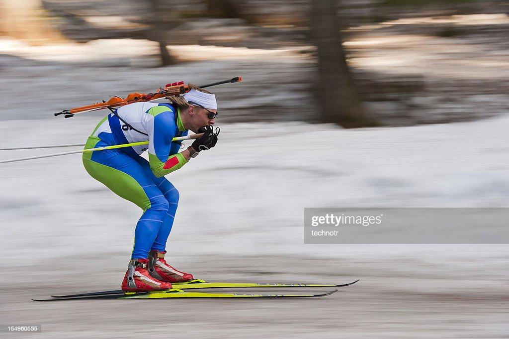 Biathlon competitor at downhill