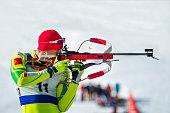 Biathlon competitor at shooting range