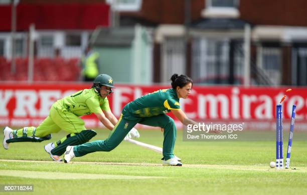 Bibi Nahida of Pakistan is run out by Marizanne Kapp of South Africa during the ICC Women's World Cup match between Pakistan and South Africa at...