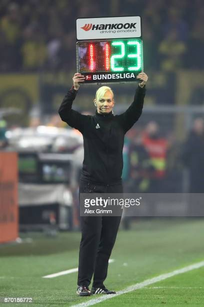 Bibiana Steinhaus holds the sign for substitutions during the Bundesliga match between Borussia Dortmund and FC Bayern Muenchen at Signal Iduna Park...