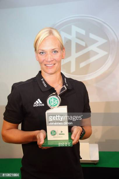 Bibiana Steinhaus poses with the award trophy after been awarded as referee of the year 2017 on July 8 2017 in Grassau Germany