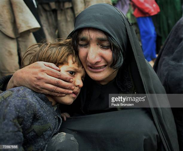 Bibijan mourns the death of her second daughter Guljan holding her son Bashir Ahmad on November 14 2006 in Herat Afghanistan She died from...