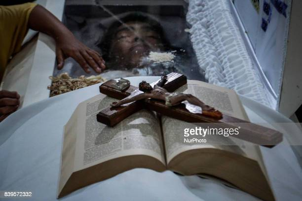 A bible and a crucifix is seen on top of the coffin of Kian Loyd Delos Santos during his funeral rites in Caloocan Metro Manila Philippines August 26...