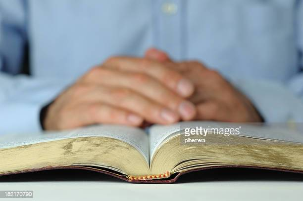 Bible and Folded Hands