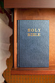 A bible in a night table drawer in a hotel room