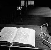 A bible lies open on a lectern