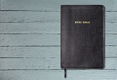 Holy Bible book on wooden background
