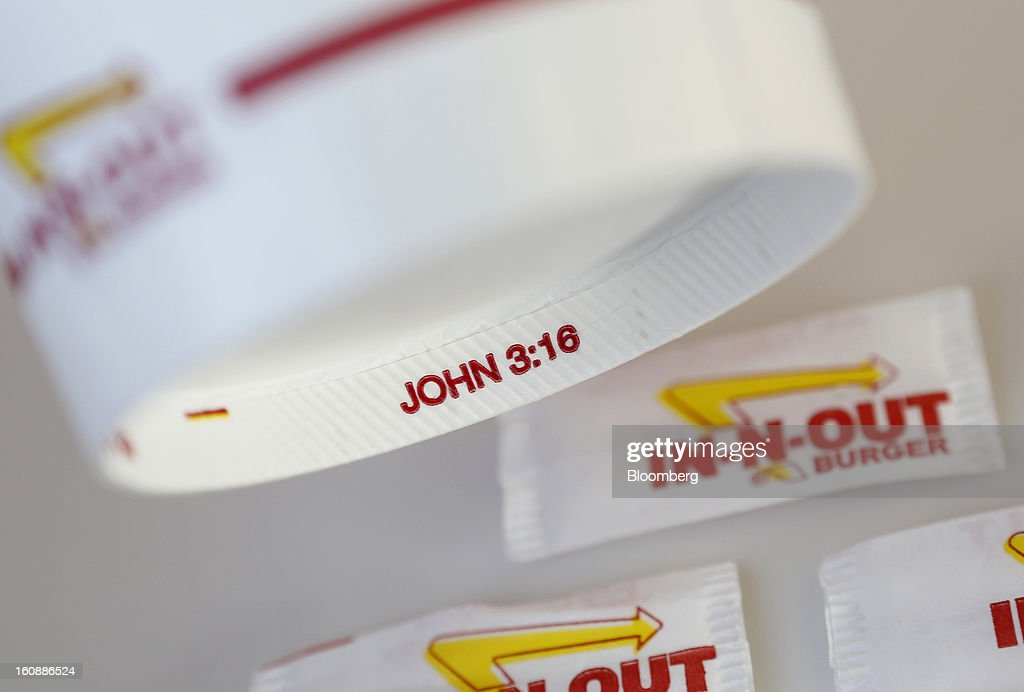 Bible verse 'John 3:16' is seen on the bottom rim of a soda cup at an In-N-Out Burger restaurant in Costa Mesa, California, U.S., on Wednesday, Feb. 6, 2013. In-N-Out, with almost 280 units in five states, is valued at about $1.1 billion based on the average price-to-earnings, according to the Bloomberg Billionaires Index. Photographer: Patrick T. Fallon/Bloomberg via Getty Images