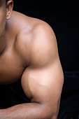 bicep and shoulder isolated on black