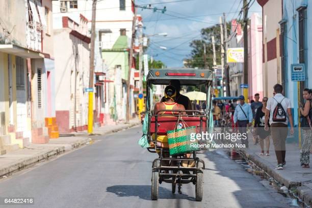 Bicitaxis or tricycles transporting passengers in city Economic hardship has made human traction transportation an affordable way to move in urban...