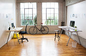 Bicycle and desks in modern office