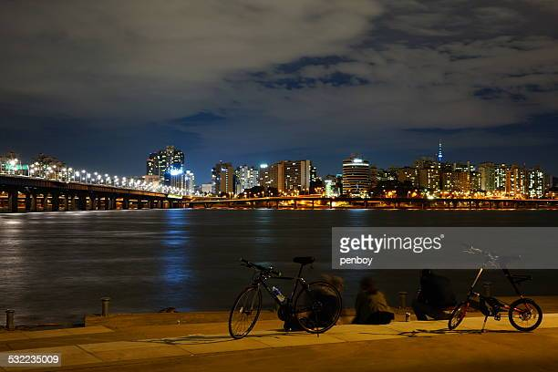 Bicycle and riverside night view