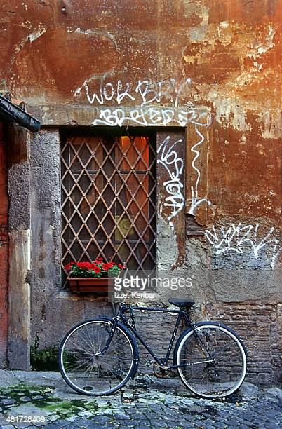 Bicycle and window near red wall in Trastevere