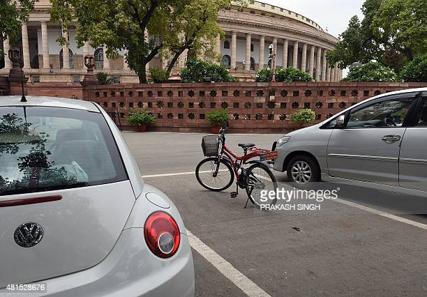 A bicycle belonging to Bhartiya Janata Party member of parliament from Bikaner Arjun Ram Meghwal is left in a car parking spot at the parliament...