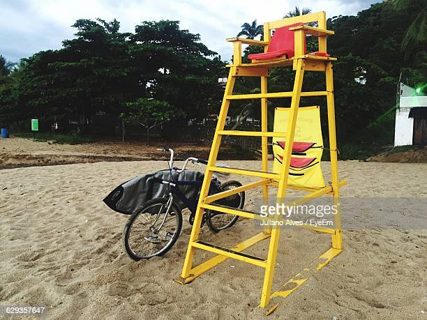 Bicycle By Lifeguard Chair At Beach