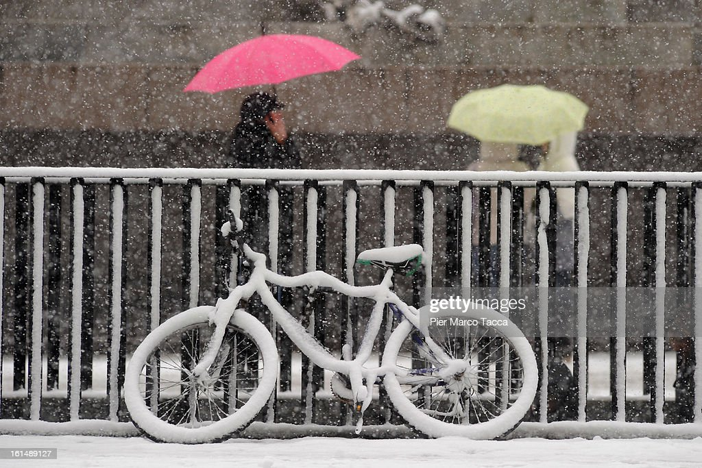 A bicycle covered with snow on February 11, 2013 in Milan, Italy.Wind, snow and tempetarture under zero over the country has affected regions from North Italy to South Italy, transports has been affected with train cancellations and road closures.