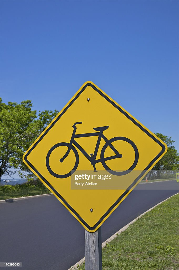 Bicycle depicted on yellow diamond-shaped sign