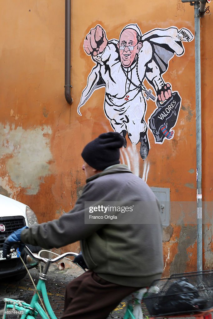 A bicycle drives past a graffiti featuring a 'superhero' version of Pope Francis appears in Borgo Pio, next to St. Peter's Square on January 29, 2014 in Rome, Italy. The image started circulating from the twitter account of the Vatican and has rapidly spread around the world.