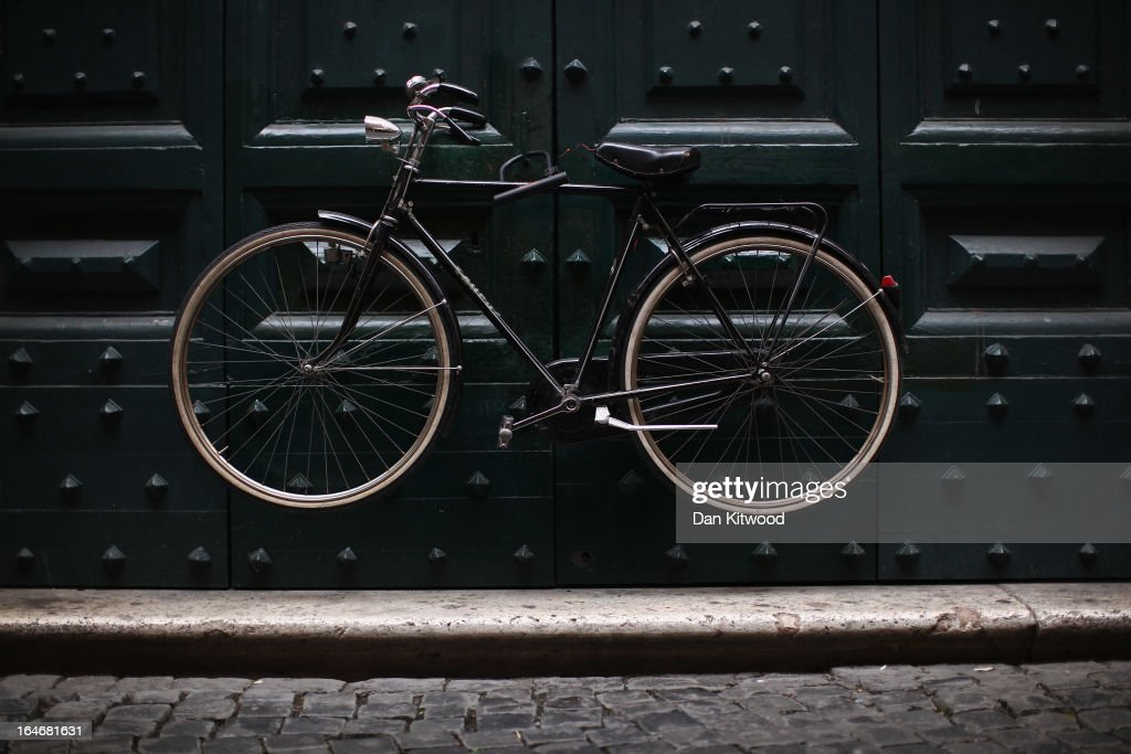 A bicycle hangs on a doorway close to the Pantheon on March 25, 2013 in Rome, Italy. Pope Francis is expected to inspire an influx of tourism from the Americas to Rome as the first South America Pope at The Vatican.