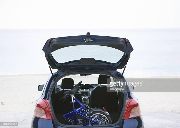 A bicycle in a car trunk