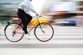 Bicycle in motion on zebra crossing
