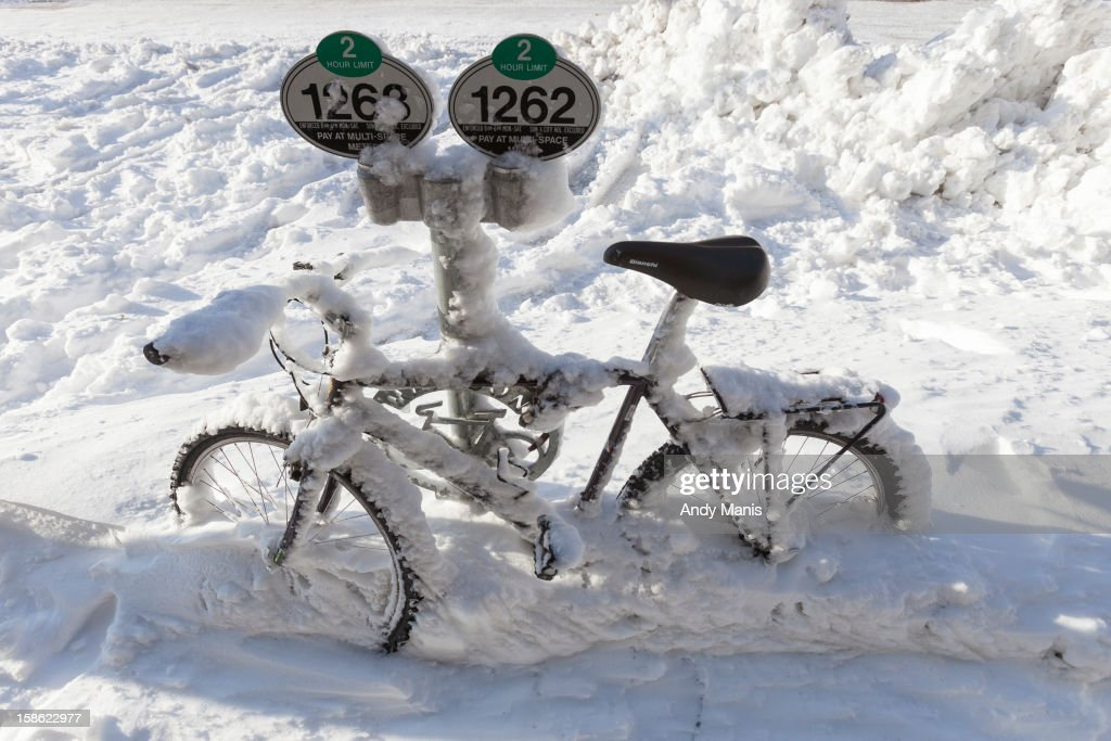 A bicycle is covered in snow December 21, 2012 in Madison, Wisconsin, a day after Wisconsin was blanketed with a record snow storm.