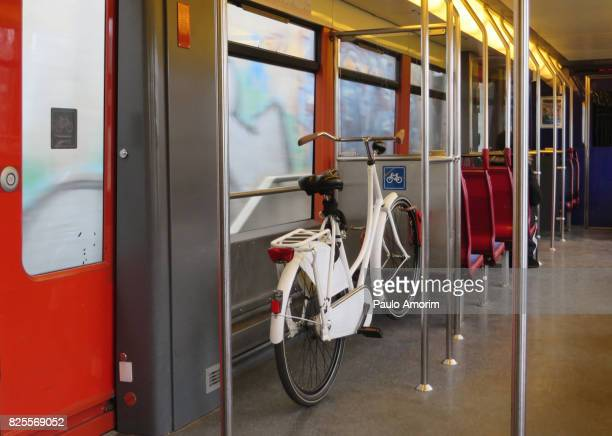 A bicycle is transported on the train in Amsterdam
