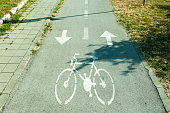 Bicycle lane with arrows and bicycle sign on the road.