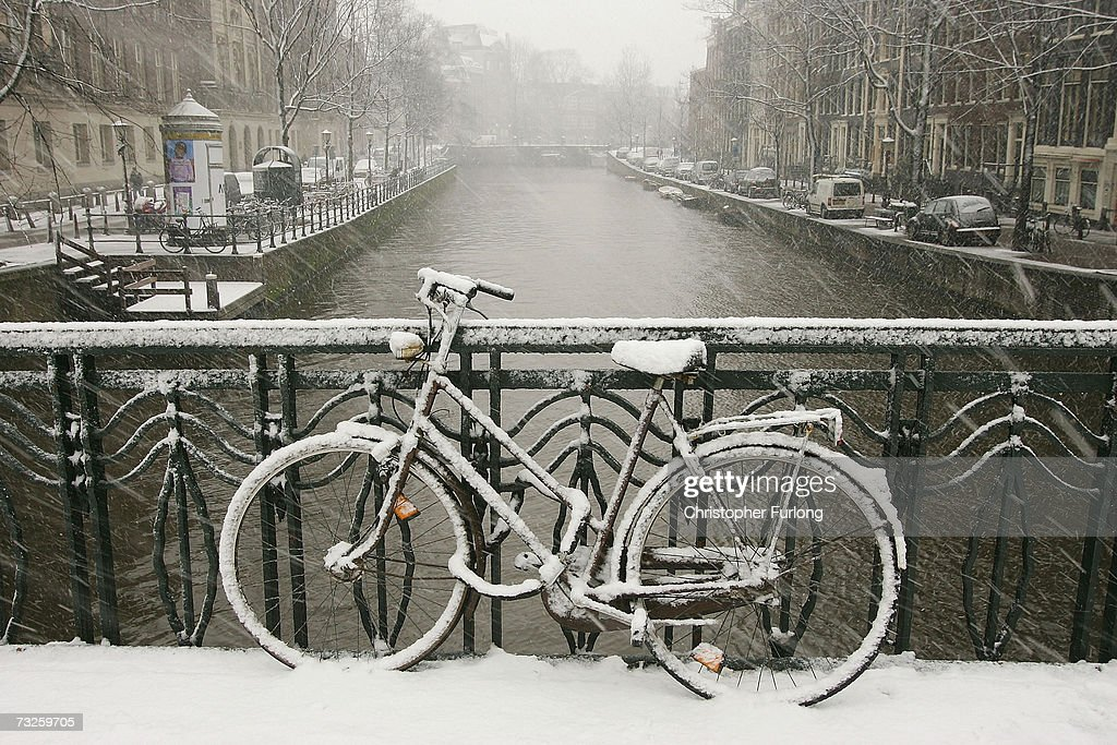 A bicycle lays covered in snow on February 8, 2007, in Amsterdam, Netherlands. The Dutch transport system has suffered delays across the country, with an expected 5-10 centimetres due to fall, according to The Dutch Meteorological Institute.