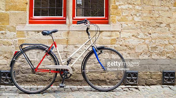 Bicycle leaning against old wall