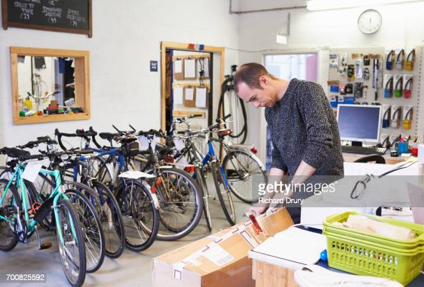 Bicycle mechanic opening box