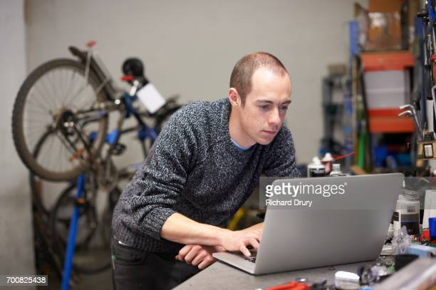 Bicycle mechanic using laptop