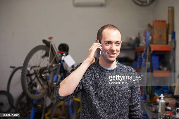 Bicycle mechanic using mobile phone