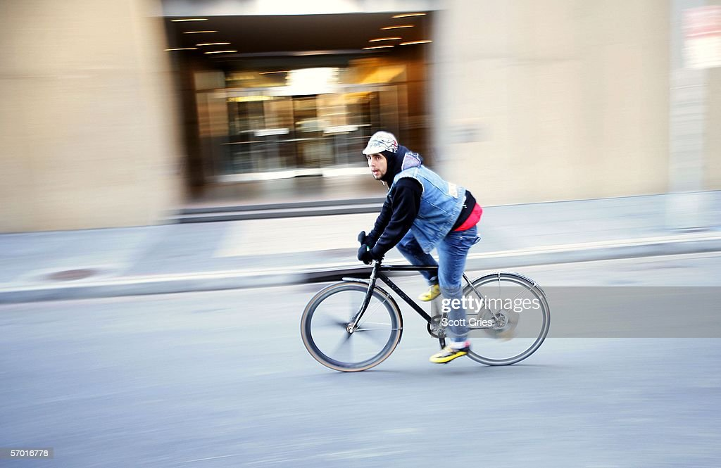 A bicycle messenger rides during Monster Track 2006 March 4, 2006 in New York City. Monster Track is an illegal bike race throughout New York City for bicycle messengers that involves racing from checkpoint to checkpoint on bikes with no brakes.