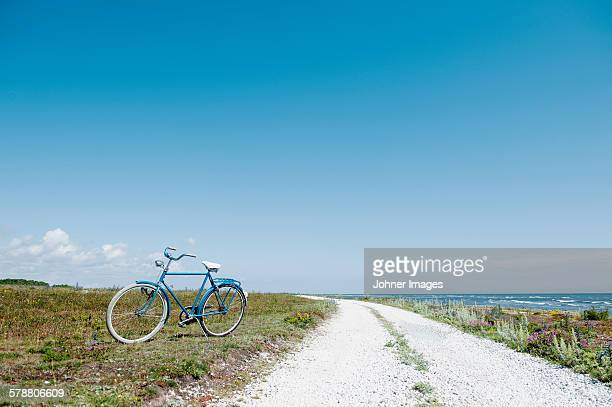Bicycle on side of road at sea