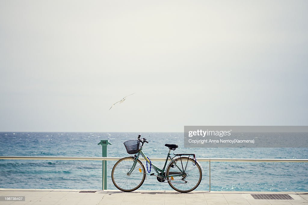 Bicycle on the sea promenade over blue sky : Stock Photo